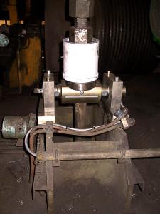 Tourillon dynamométrique placé sur une tige de traction